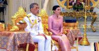 Король Таиланда Маха Ватчиралонгкон (Рама Х) и Суттхида Ватчиралонгкон во время свадебной церемонии