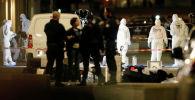 Судмедэксперты осматривают место взрыва в центре Лиона, Франция, 24 мая 2019 года. REUTERS / Emmanuel Foudrot