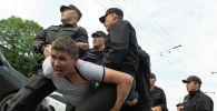Задержание участника митинга в Алматы