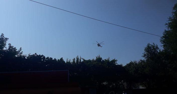 Вертолет, задействованный в тушении пожара