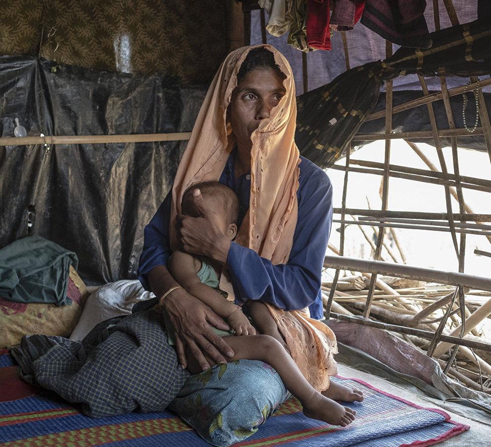 Марджон (35 лет) с двухлетним сыном Мухамедом. Оба страдают острой респираторной инфекцией.