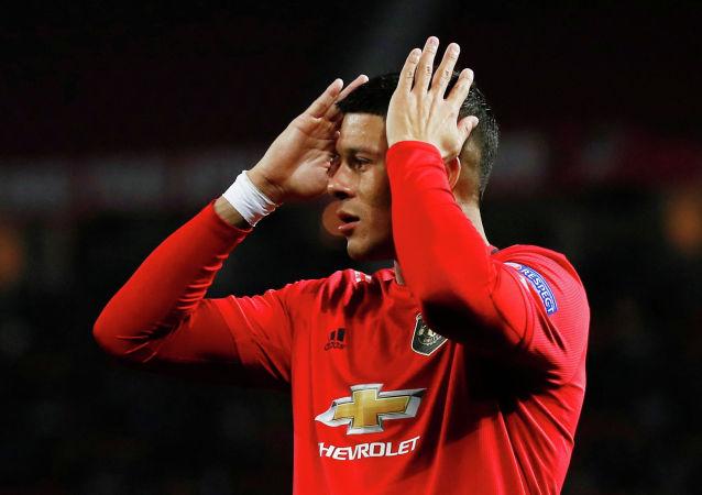 Маркос Рохо из Манчестер Юнайтед реагирует на ход игры