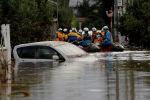 Спасатели ликивдируют последствия после тайфуна Хагибис в Японии