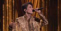 Димаш Кудайберген во время выступления на шоу The World's Best