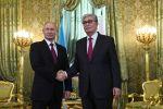 Президент РФ Владимир Путин и президент Казахстана Касым-Жомарт Токаев, архивное фото