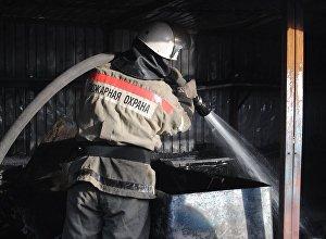 Архивное фото пожарного