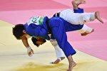 Беслан Мудранов (Россия) и Елдос Сметов (Казахстан) в финальном поединке соревнований по дзюдо в весовой категории до 60 кг на XXXI летних Олимпийских играх, архивное фото
