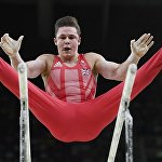 Бринн Беван из Соединенного Королевства выступает на брусьях. Олимпиада в Рио.