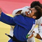 Беслан Мудранов (Россия) и Елдос Сметов (Казахстан)на XXXI летних Олимпийских играх.