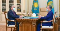 Президент Казахстана Касым-Жомарт Токаев и спикер мажилиса Нурлан Нигматулин