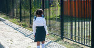 Первоклассница у школы