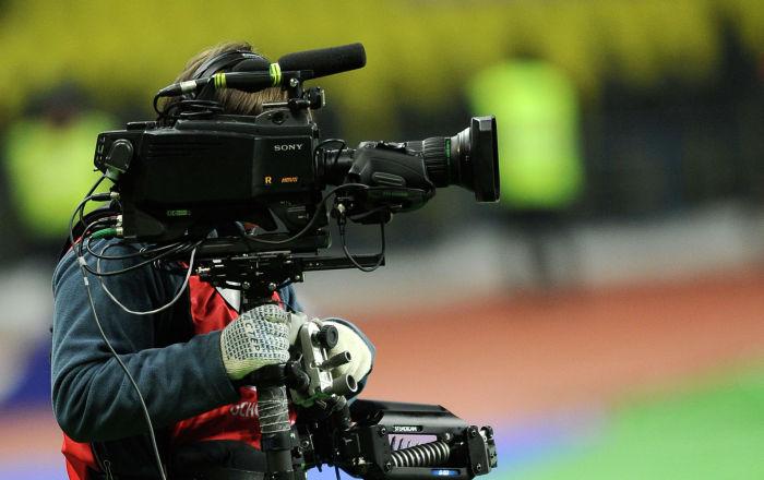 Видеооператор на футбольном поле