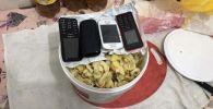 Четыре телефона пытались спрятать в блюде с макаронам в СИЗО Атырау