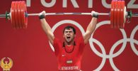 Олимпийский чемпион по тяжелой атлетике из Узбекистана Акбар Джураев