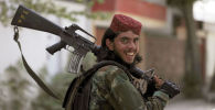 Боевик Талибана* во время патрулирования Кабула