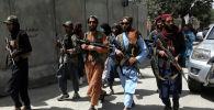 Боевики Талибана* на улицах Кабула
