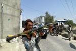 Боевик Талибана* на улице Кабула