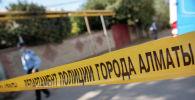 Оцепление места массового убийства, где алматинец расстрелял пять человек, в том числе двух полицейских и судисполнителя