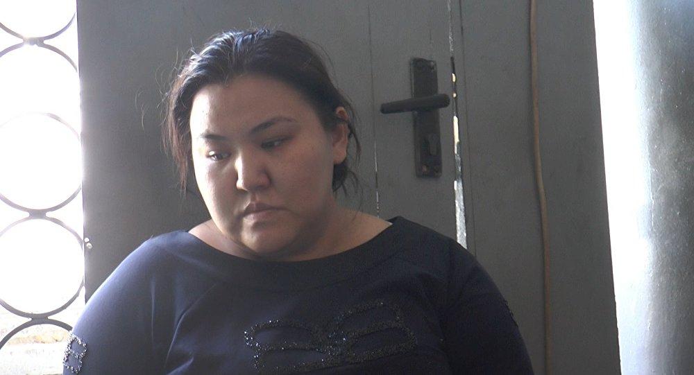 Маржан Ахметова, подозреваемая в мошенничестве