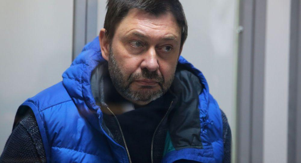 Руководитель портала РИА Новости Украина Кирилл Вышинский в Подольском районном суде Киева, который рассматривает обвинительный акт в его отношении