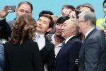 Елбасы Нурсултан Назарбаев и президент Касым-Жомарт Токаев позируют для фотографий с участниками съезда Нур Отан, архивное фото