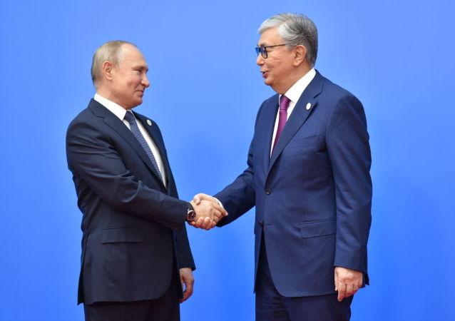 Президент Казахстана Касым-Жомарт Токаев и глава России Владимир Путин, архивное фото