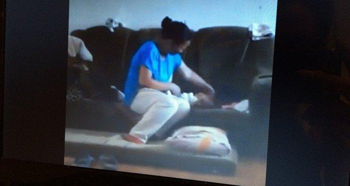 Фото видеозаписи избиения младенца
