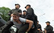 Задержание участника митинга в Алматы, архивное фото
