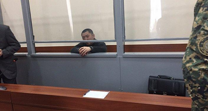 Юрий Пак в клетке для подсудимых