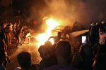 Горящий после взрыва автомобиль в Каире