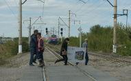 Фото с места ЧП на перегоне Алматы - Шамалган , где автобус столкнулся с поездом