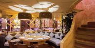 Модный интерьер ресторана Arnau отличается национальными мотивами, уютом и великолепием обстановки