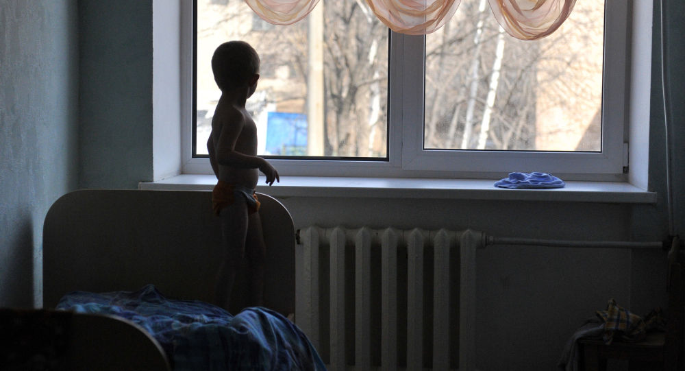 Архивное фото ребенка в детском саду