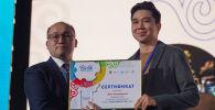 Награждение волонтеров. Диас Камериданов, 1-е место в номинации  Media-волонтер