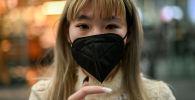Женщина в защитной маске от распространения коронавируса в Международном аэропорту Мехико (29 января 2020). Мексика