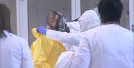Путин в респираторе и защитном костюме: видео из больницы