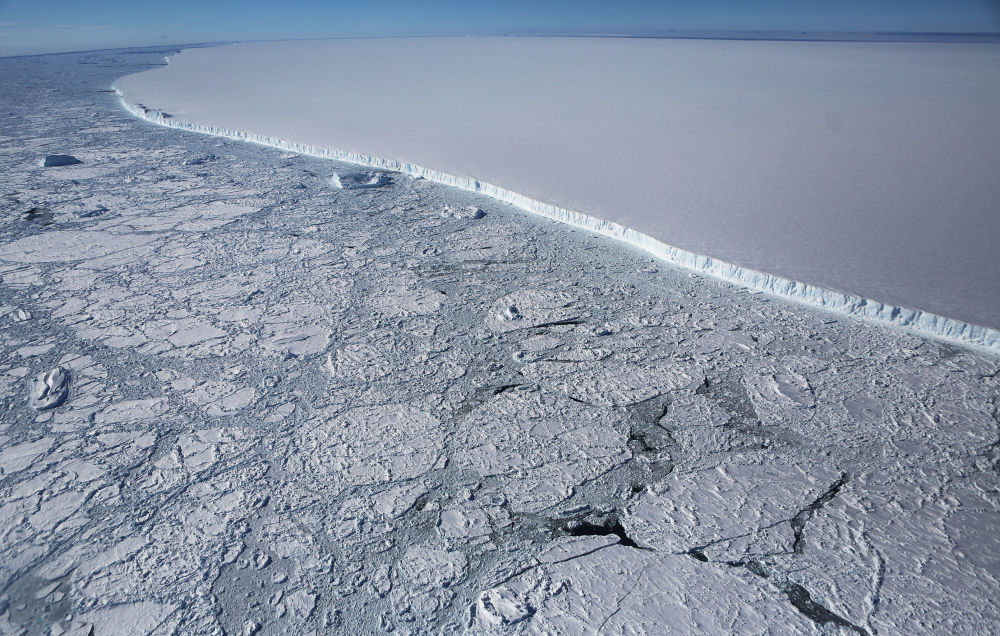 UNSPECIFIED, ANTARCTICA - OCTOBER 31: The western edge of the famed iceberg A-68 (TOP R), calved from the Larsen C ice shelf, is seen from NASA's Operation IceBridge research aircraft, near the coast of the Antarctic Peninsula region, on October 31, 2017, above Antarctica. The massive iceberg was measured at approximately the size of Delaware when it first calved in July. NASA's Operation IceBridge has been studying how polar ice has evolved over the past nine years and is currently flying a set of nine-hour research flights over West Antarctica to monitor ice loss aboard a retrofitted 1966 Lockheed P-3 aircraft. According to NASA, the current mission targets 'sea ice in the Bellingshausen and Weddell seas and glaciers in the Antarctic Peninsula and along the English and Bryan Coasts.' Researchers have used the IceBridge data to observe that the West Antarctic Ice Sheet may be in a state of irreversible decline directly contributing to rising sea levels. The National Climate Assessment, a study produced every 4 years by scientists from 13 federal agencies of the U.S. government, released a stark report November 2 stating that global temperature rise over the past 115 years has been primarily caused by 'human activities, especially emissions of greenhouse gase