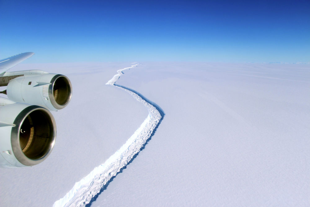These photograph shows the wide view of the rift in Larsen C from the vantage point of NASA's DC-8 research aircraft. NASA scientist John Sonntag snapped the photos on November 10, 2016, during an Operation IceBridge flight. The mission, which makes airborne surveys of changes in polar ice, completed its eighth consecutive Antarctic deployment later that month. The rift in Larsen C measures about 100 meters (300 feet) wide and cuts about half a kilometer (one-third of a mile) deep—completely through to the bottom of the ice shelf. While the rift is long and growing longer, it does not yet reach across the entire shelf.