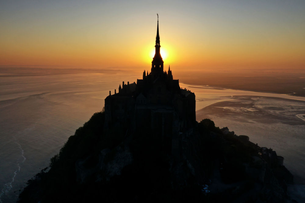 This aerial picture shows Le Mont-Saint-Michel, in Normandy, north western France, at sunrise on April 23, 2020 during the 38th day of a strict lockdown aimed at curbing the spread of the COVID-19 pandemic, caused by the novel coronavirus.