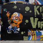 LAS VEGAS, NEVADA - MAY 11: A Kill the Virus mural covers plywood boards at the shuttered Evel Knievel-themed Evel Pie restaurant in the Fremont East Entertainment District amid the continuing spread of the coronavirus (COVID-19) on May 11, 2020 in Las Vegas, Nevada. Some restaurants opened over the weekend as part of a Phase One reopening plan that allows dine-in restaurants, hair and nail salons, some retail stores, and other nonessential businesses to reopen with strict social-distancing guidelines and occupancy restrictions in place.