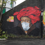 Street art depicting a painting by Jan van Eyck with a face mask is seen in Ladywell, as the spread of the coronavirus disease (COVID-19) continues, London, Britain, April 18, 2020.