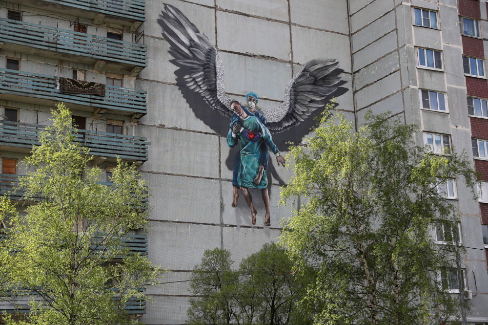 A view shows an apartment block, which is decorated with a mural dedicated to medical specialists involved in the fight against the coronavirus disease (COVID-19), in Odintsovo outside Moscow, Russia May 14, 2020.