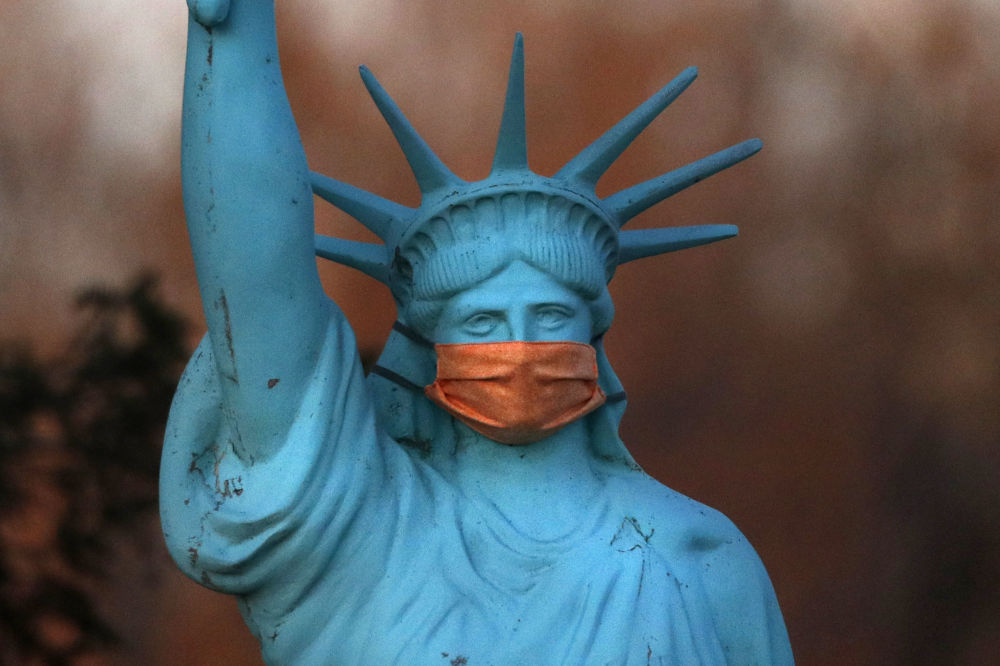 A replica of the Statue of Liberty wears a coronavirus mask outside a home on Deer Isle, Maine, Wednesday, May 6, 2020.