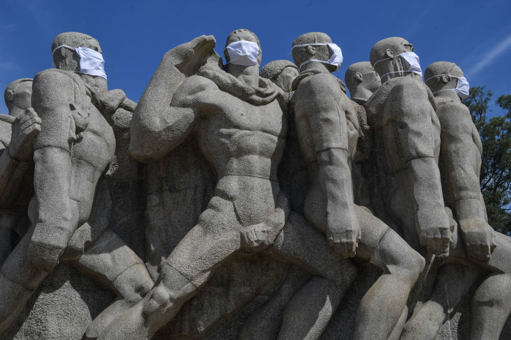 Statues of the Monumento das Bandeiras wear face masks in Sao Paulo, Brazil, on May 12, 2020, during the novel coronavirus COVID-19 pandemic. - Brazil has emerged as the epicenter of the pandemic in Latin America, with 11,519 deaths so far.
