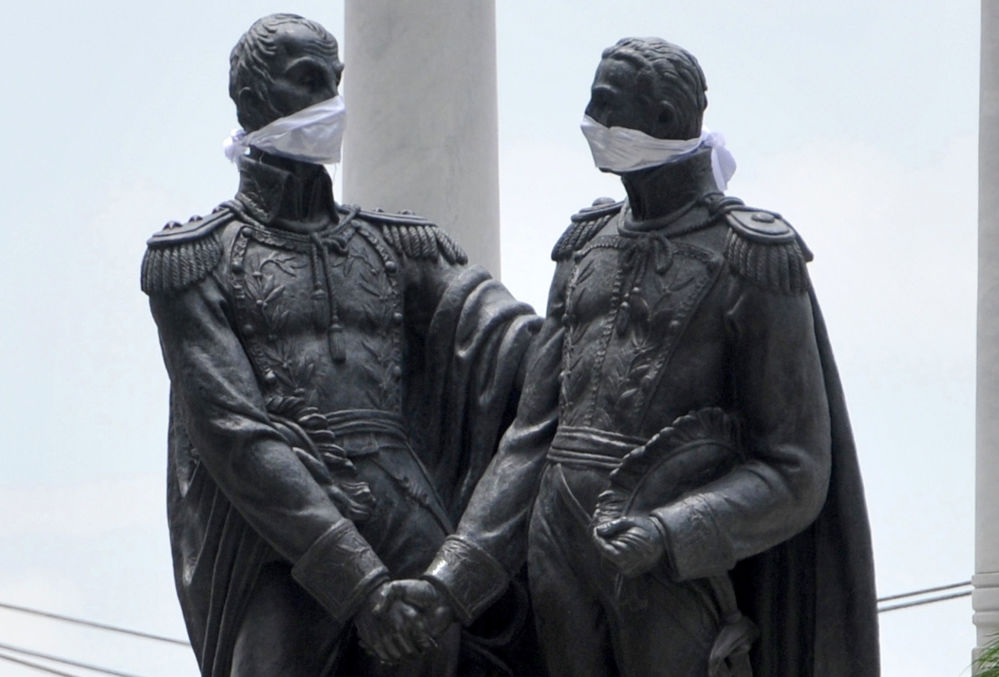 View of the monument to Liberators Simon Bolivar and Jose de San Martin bearing face masks in Guayaquil, Ecuador, on April 14, 2020 during the novel coronavirus COVID-19 pandemic. - Guayaquil is one of the COVID-19 worst hit cities in Latin America.