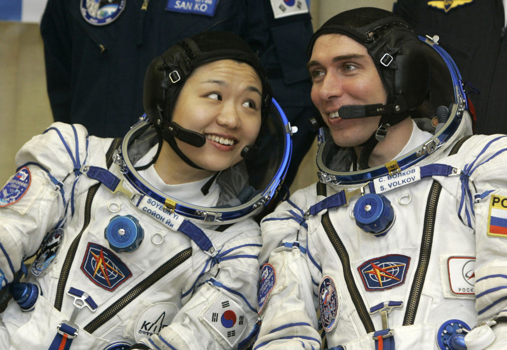South Korea's first astronaut Yi So-yeon, left, and  Russian cosmonaut, commander Sergei Volkov, crew members of the 17th mission to the International Space Station (ISS) speak prior to the launch of their Soyuz-FG  rocket at the  Baikonur Cosmodrome, Kazakhstan, Tuesday, April 8, 2008.