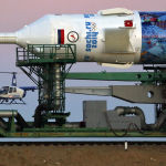 A Russian police helicopter guards the Russia's booster rocket Soyuz-FG with the space capsule Soyuz TMA-11M that will carry new crew to the International Space Station (ISS) as the rocket is transported from hangar to the launch pad at the Russian leased Baikonur cosmodrome, Kazakhstan, Tuesday, Nov. 5, 2013. The rocket is emblazoned with the emblem of the Winter Olympics in Sochi. For the first time, it will also carry an Olympic torch to space as part of the ongoing Olympic torch relay. The torch will be brought back along with the station's current crew. The rocket is scheduled to blast off on Thursday, Nov. 7.