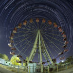 The International Space Station (ISS) moves in a straight line across the sky from left to right, along its orbit above a Ferris wheel in Russian leased Baikonur cosmodrome, Kazakhstan, Monday, Sept. 23, 2019, as stars move in an arc around the Polar Star. The new Soyuz mission to the International Space Station (ISS) is scheduled on Wednesday, Sept 25 with Russian cosmonaut Oleg Skripochka, U.S. astronaut Jessica Meir and United Arab Emirates astronaut Hazza Al Mansouri.