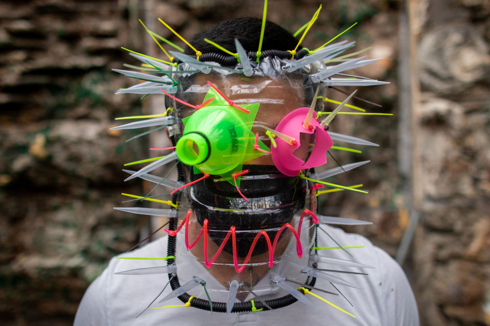 Filipino artist Leeroy New poses with a makeshift mask he designed with recycled materials as he adapts to the effects of the coronavirus disease (COVID-19) pandemic in the art industry, in his studio in Quezon City, Metro Manila, Philippines, May 28, 2020.