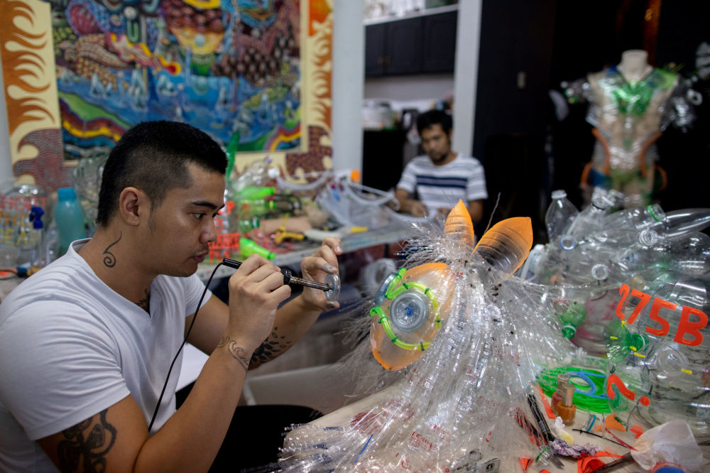 Filipino artist Leeroy New designs a makeshift mask with recycled materials for protection against the coronavirus disease (COVID-19) in his studio, in Quezon City, Metro Manila, Philippines, May 28, 2020.